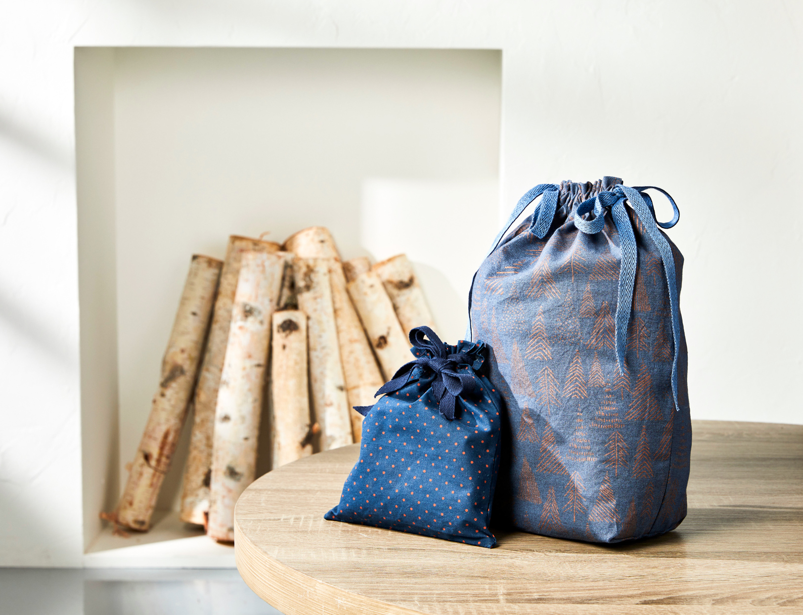 2 blue bags with ties on top