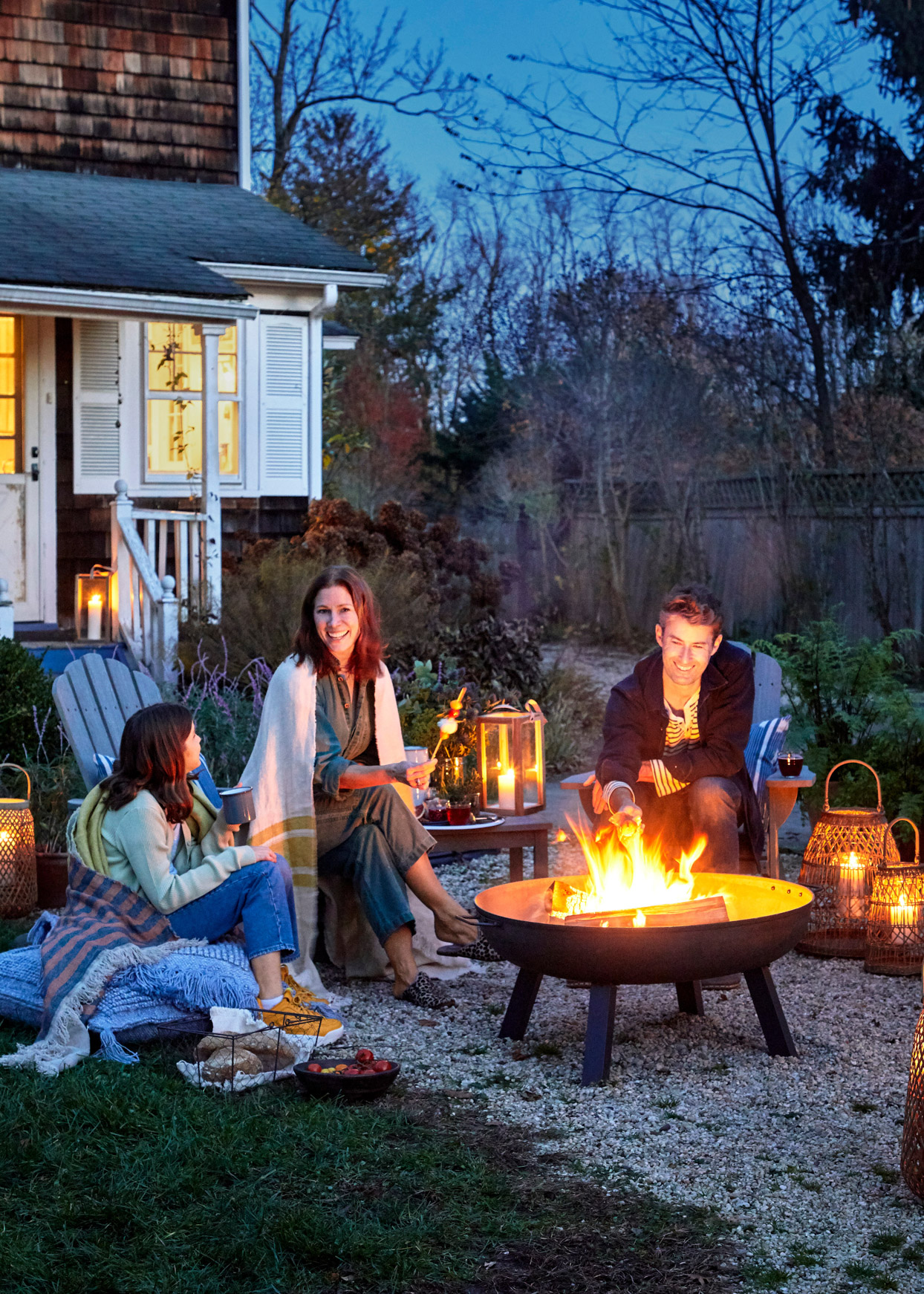 family seated around the fire pit