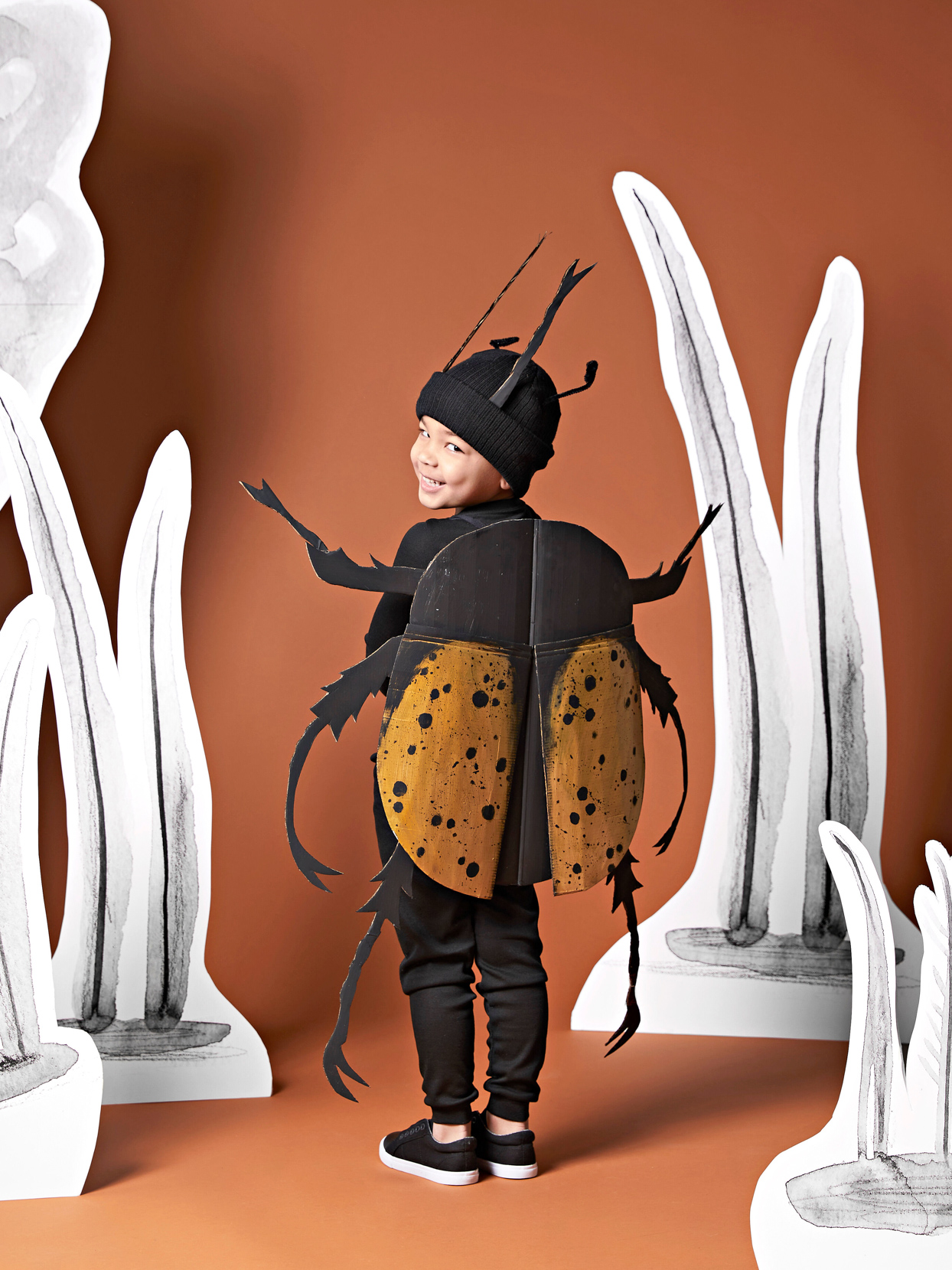 young boy black gold beetle costume back