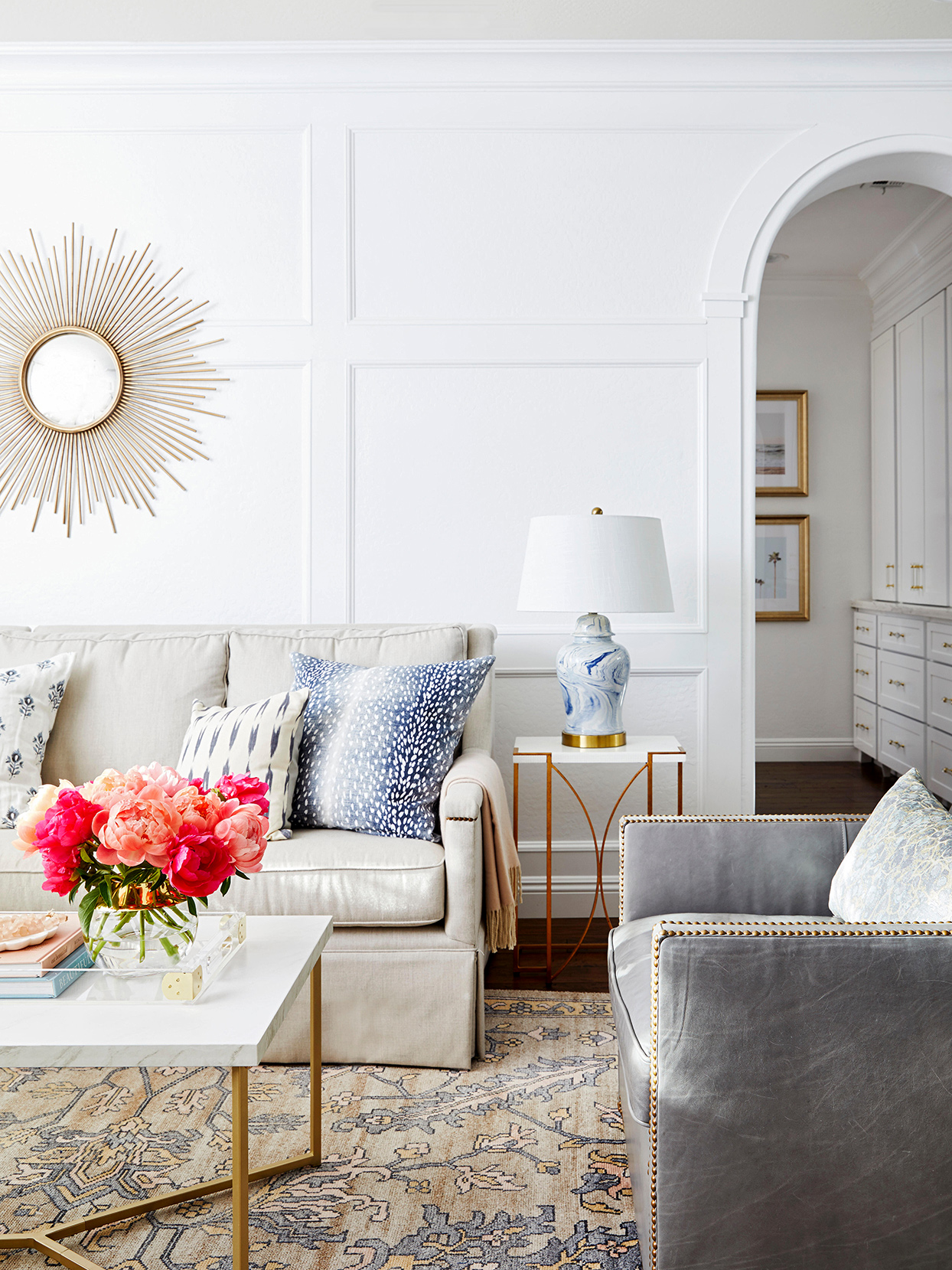 bright living room white walls panels arched doorway