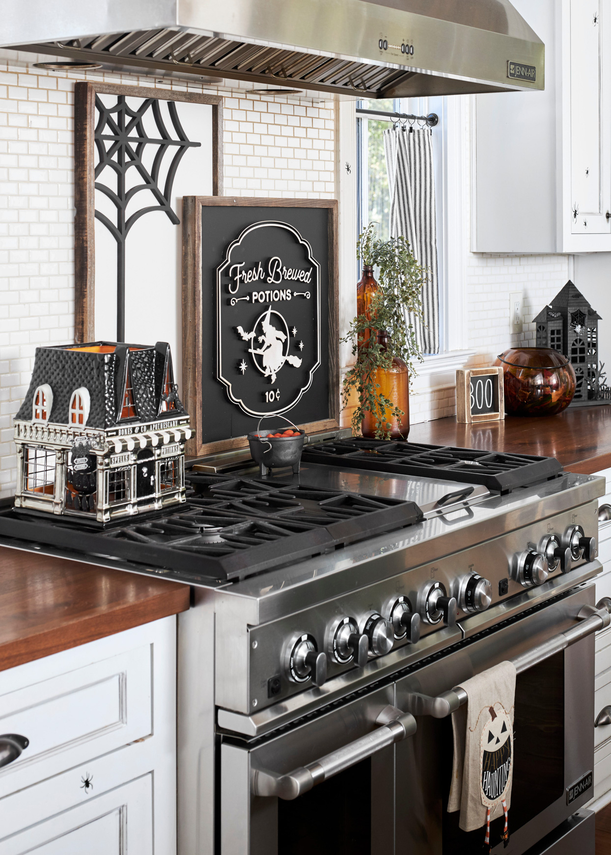 halloween kitchen decor with decorative haunted house on stovetop