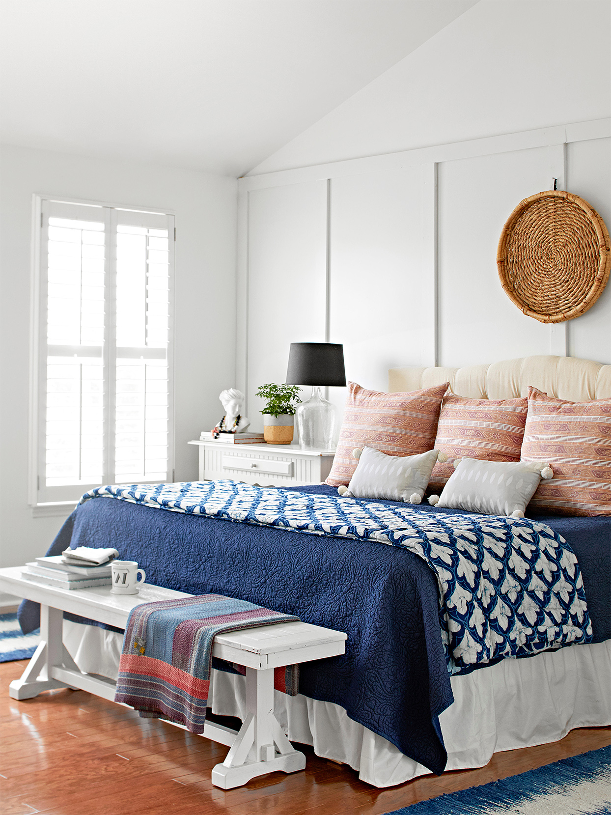 white bedroom wall panels vaulted ceiling blue coverlet