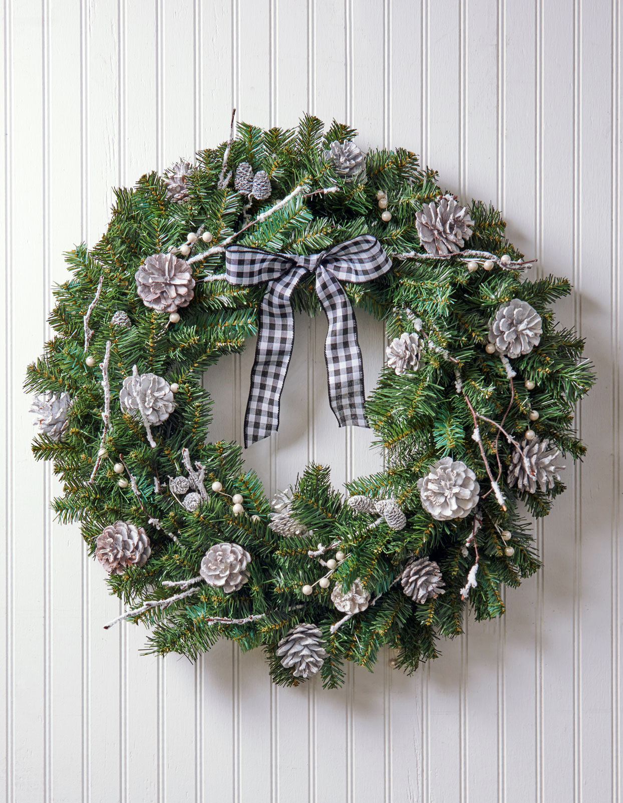 silver pinecone wreath with plaid bow