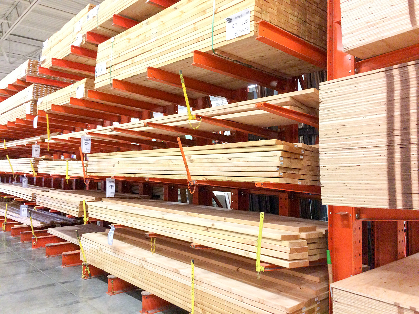 shelves of lumber wood at a hardware store for home repair