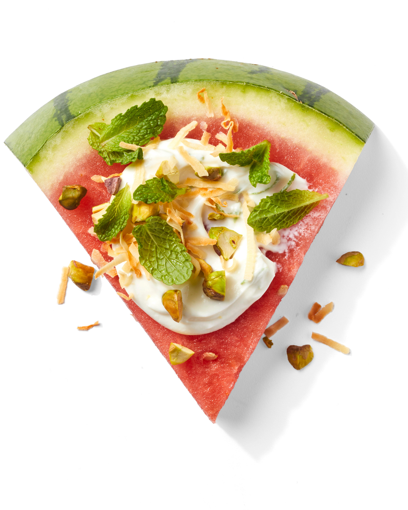 Watermelon Wedge topped with yogurt, mint, and pistachios