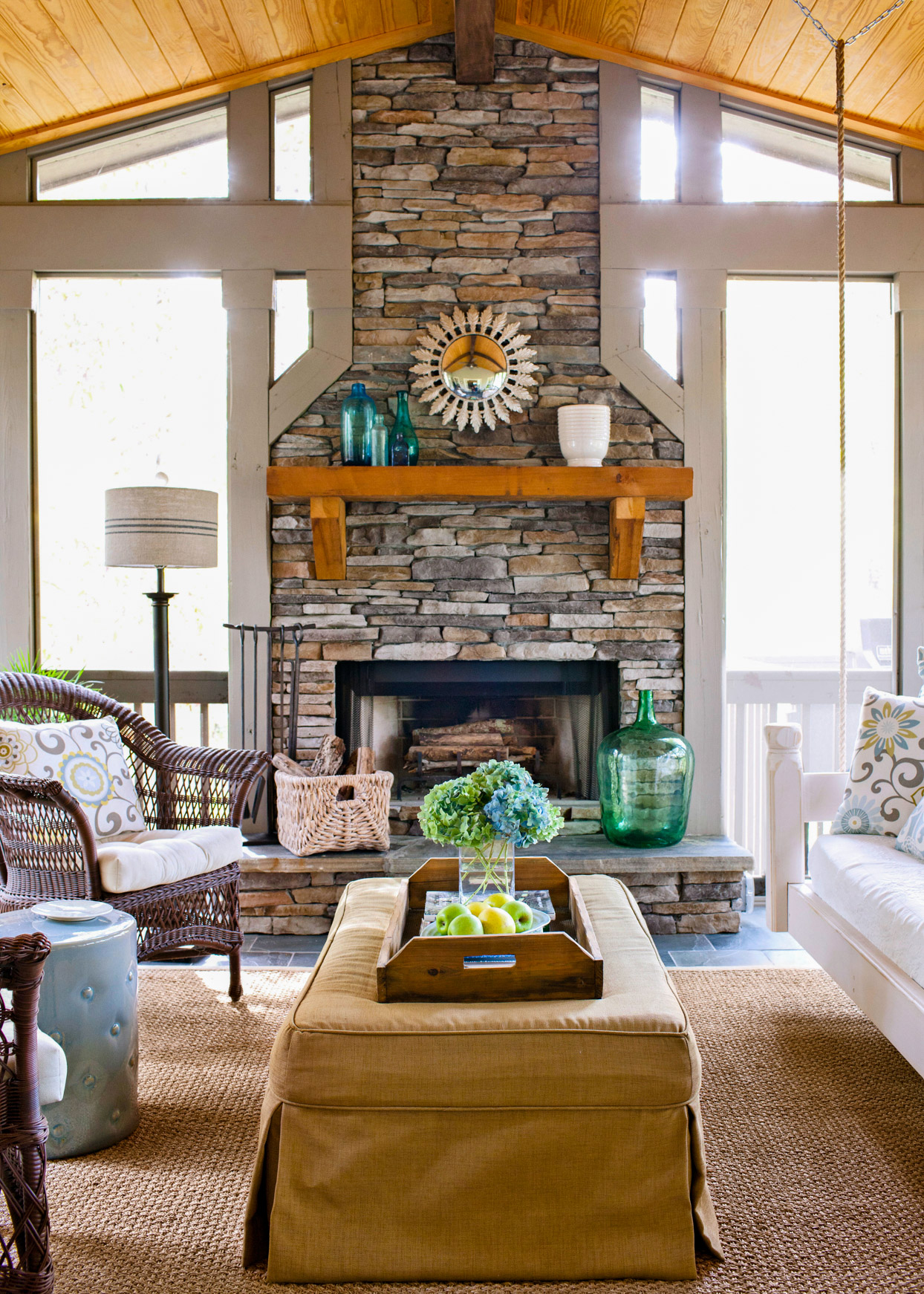 natural stone fireplace with wooden mantel