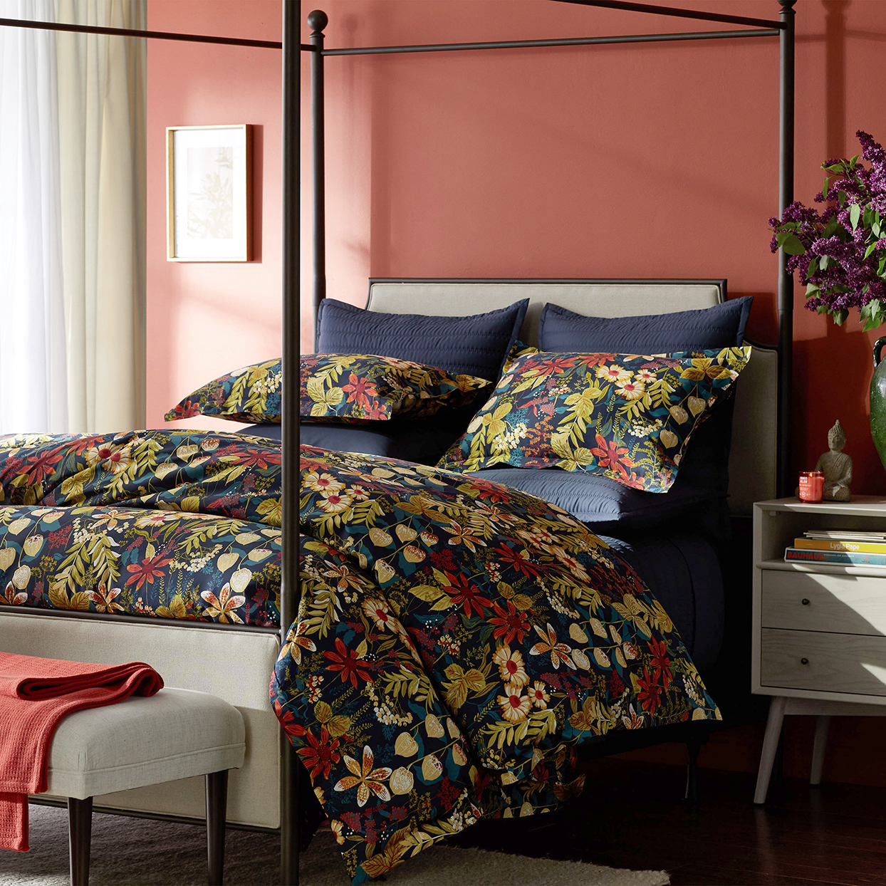 red bedroom with multi-colored floral bedding