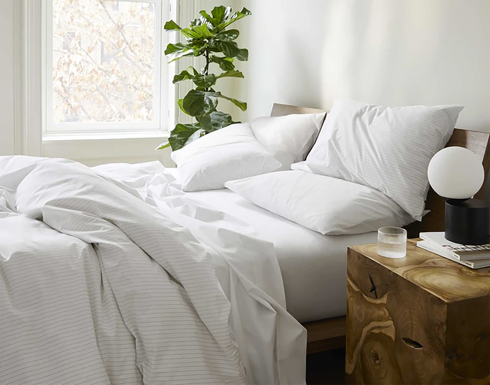 brooklinen cooling percale sheets in a nicely styled bedroom