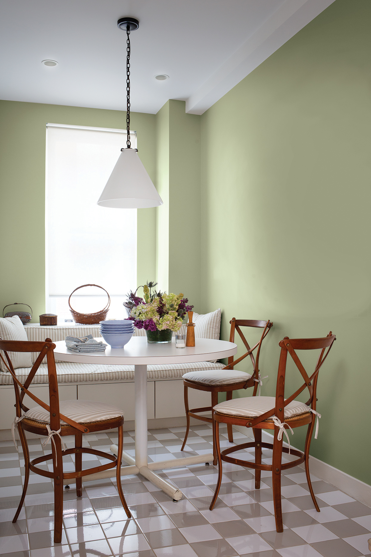 kitchen dining nook with light green walls