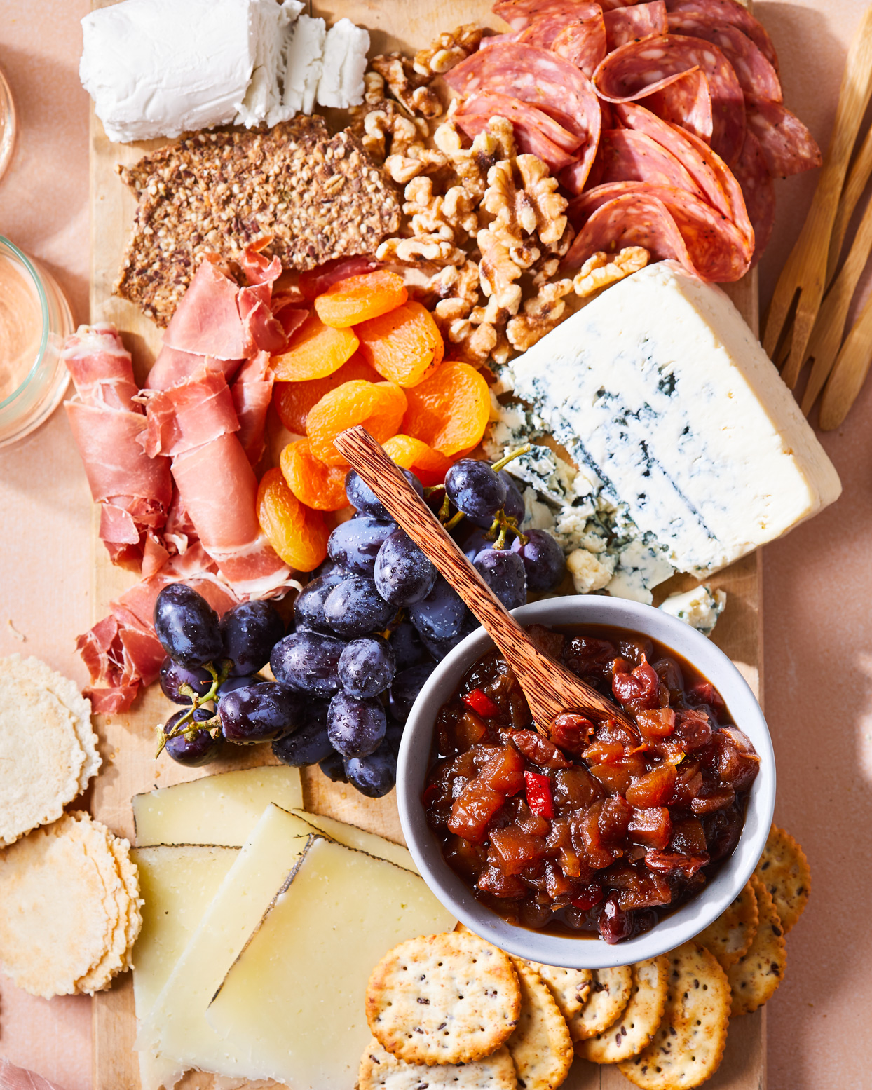 Apple-Cherry Chutney on charcuterie board with crackers, cheese fruit, and cured meats