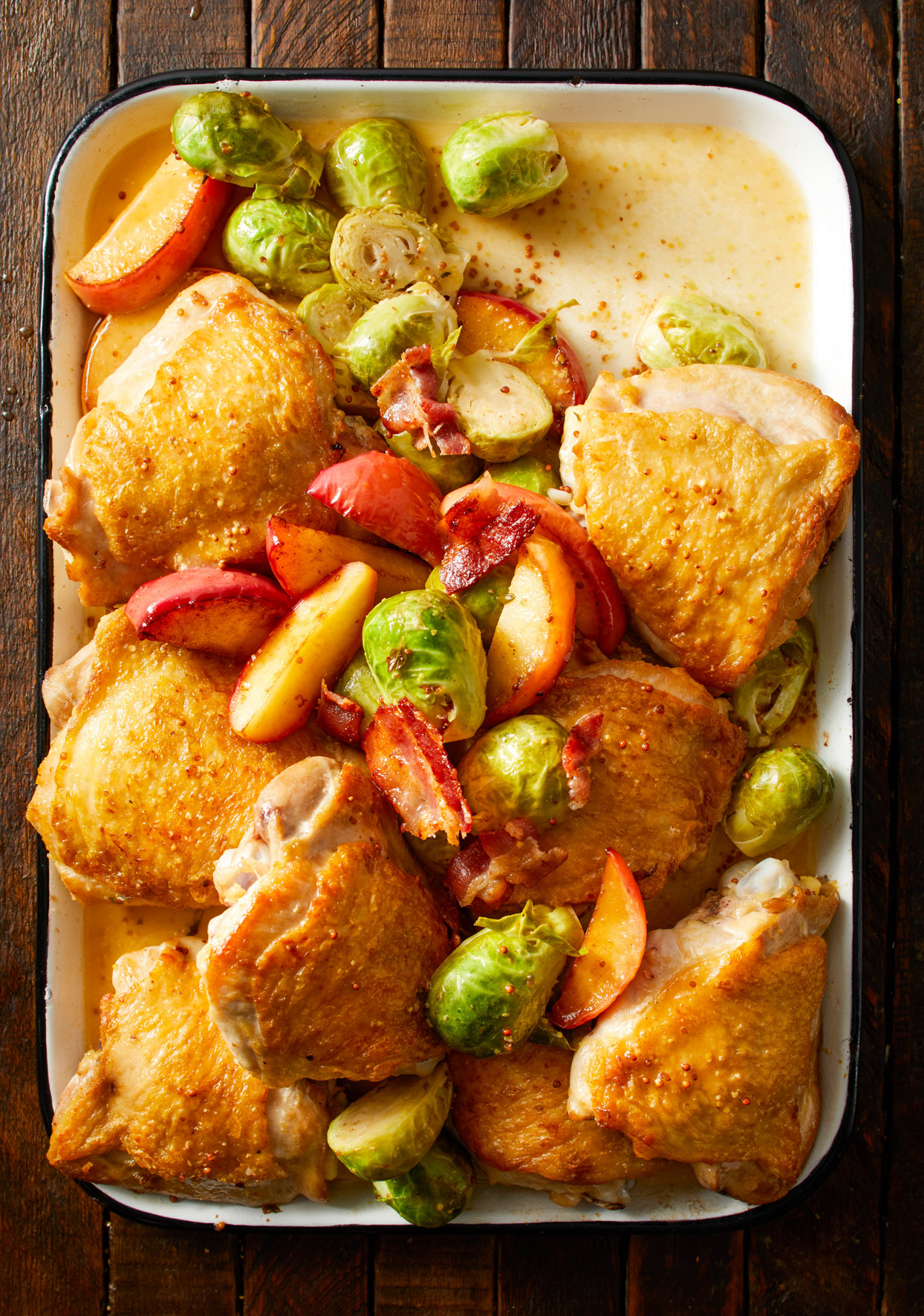 Roasting pan with Cider-Braised Chicken, Brussels Sprouts and Apples