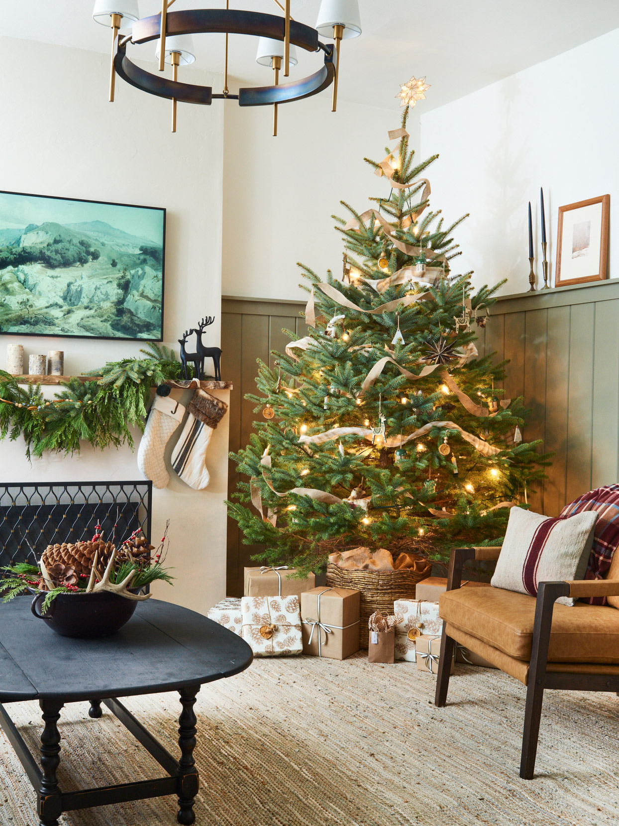 living room with christmas tree and presents