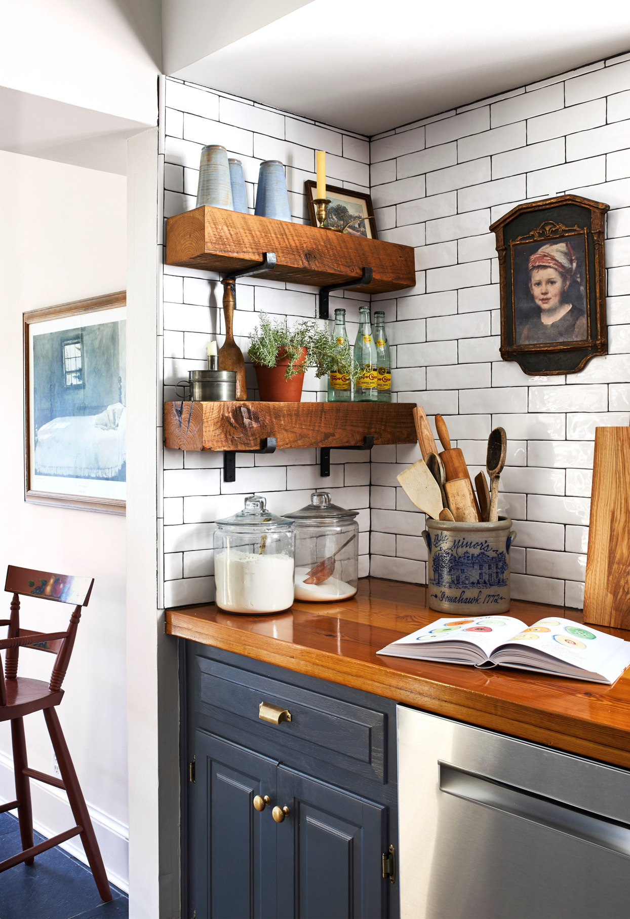 exposed wood shelves in navy and white kitchen