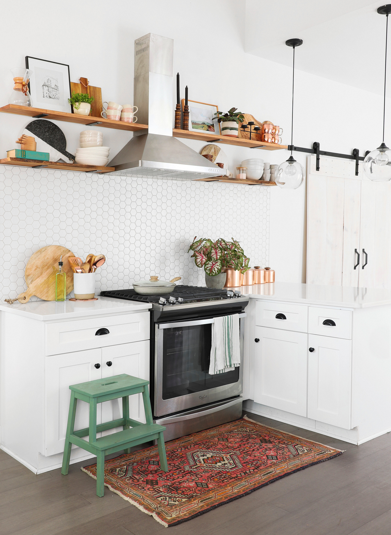 kitchen with wooden shelving and white cabinets