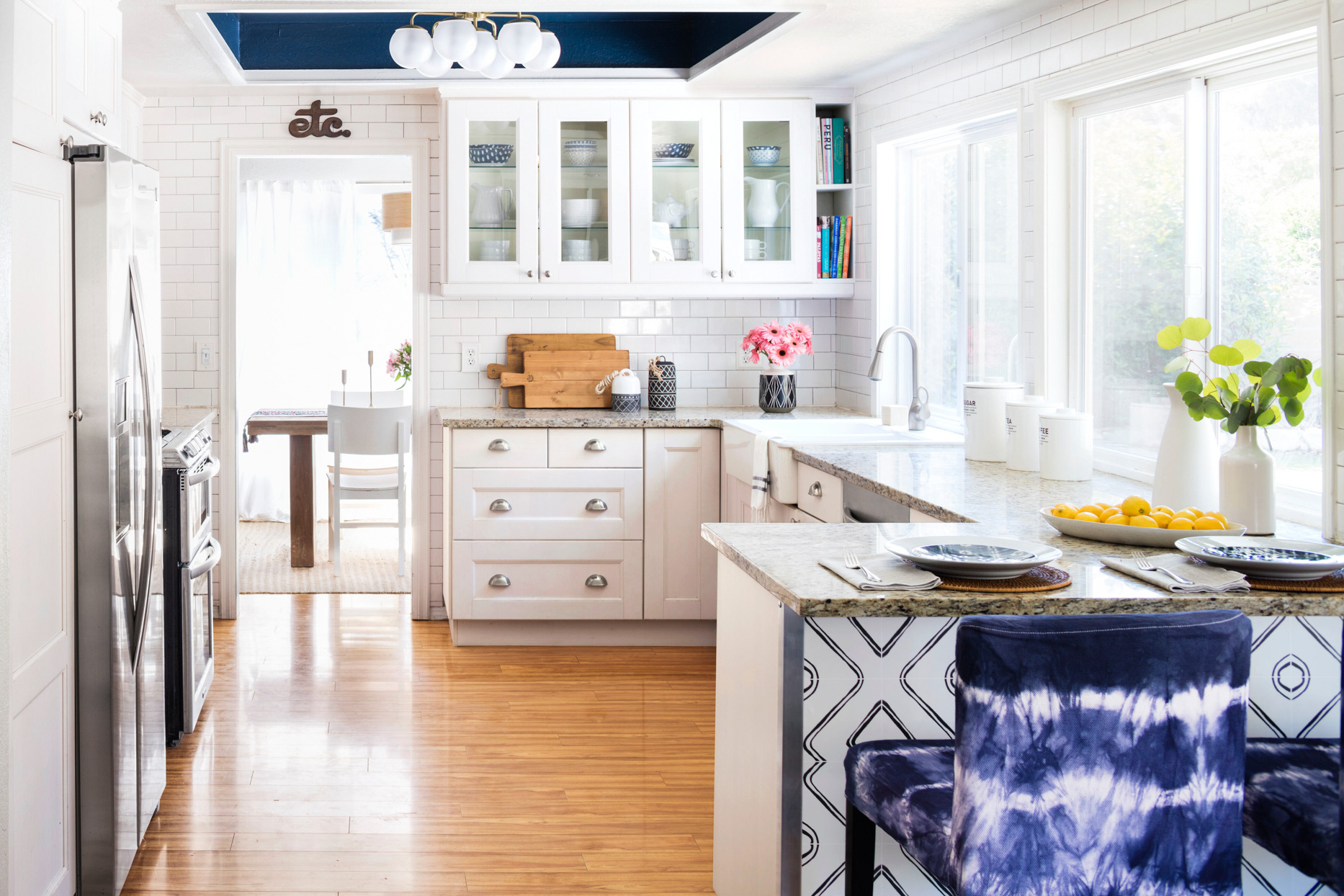 kitchen with subway tile and white cabinets