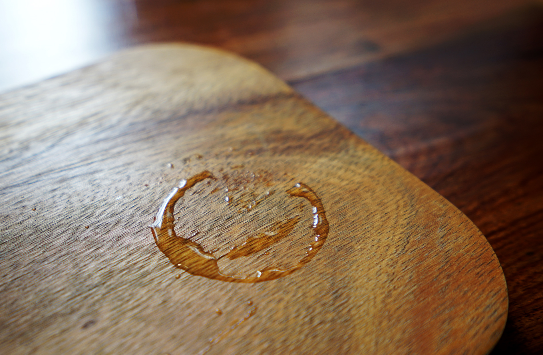 water in from glass on on wooden surface that could become of a stain