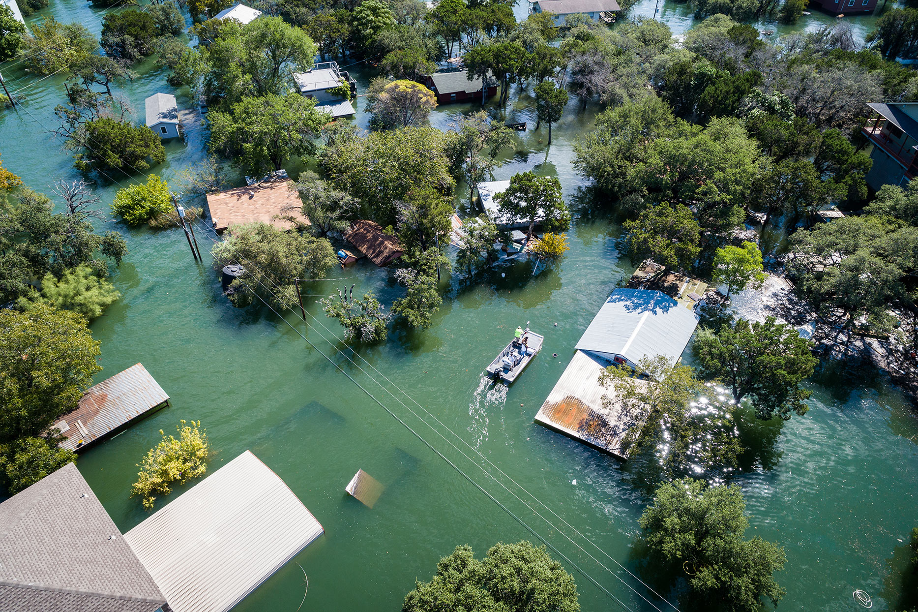 overhead view of flooded homes from extreme weather