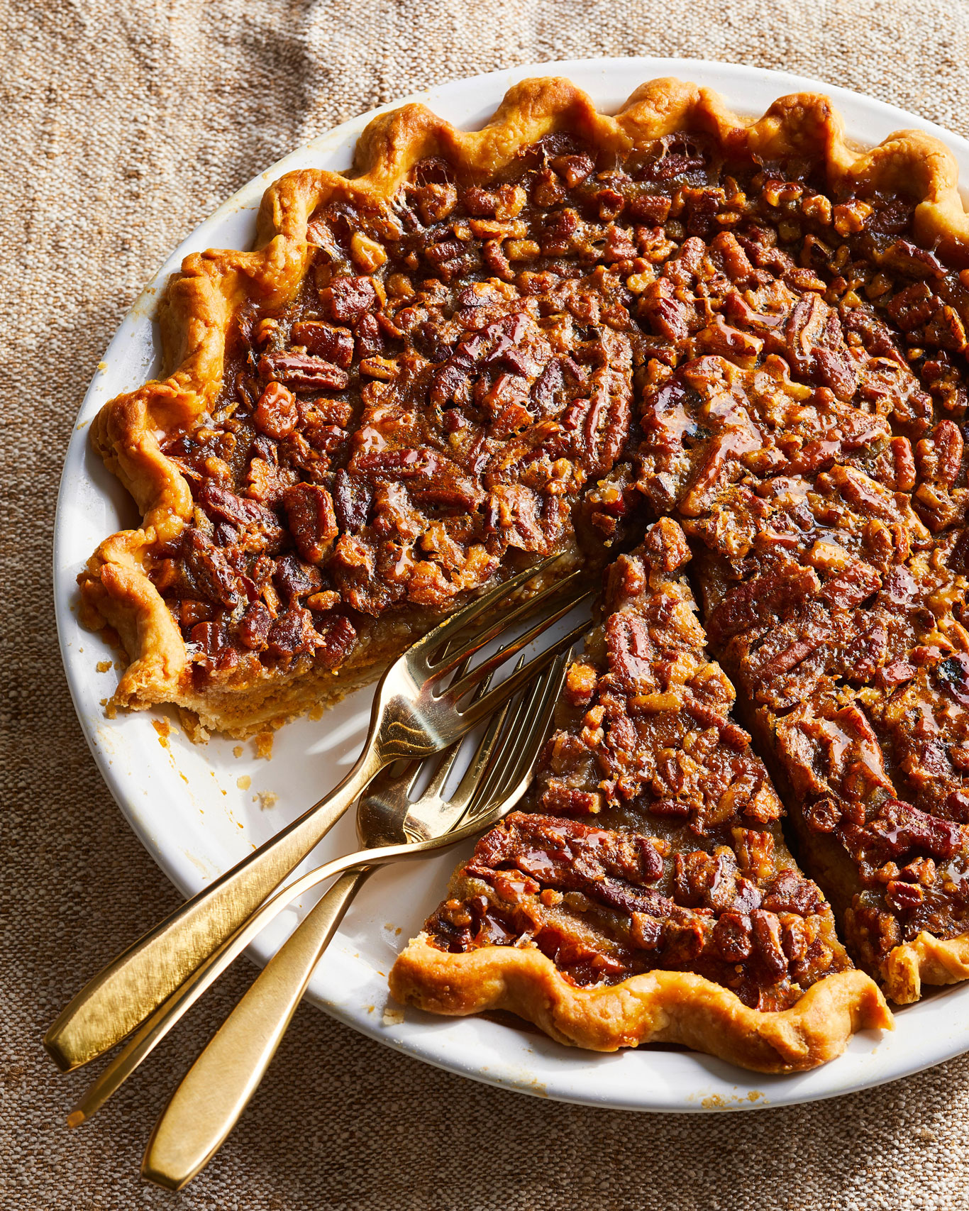 Pumpkin-Pecan Pie with slice removed and forks