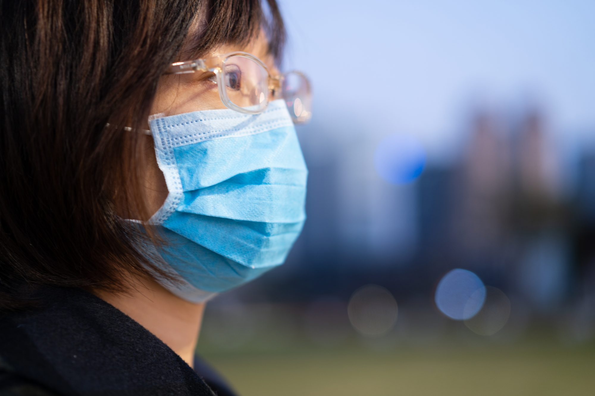 woman wearing protective mask in city