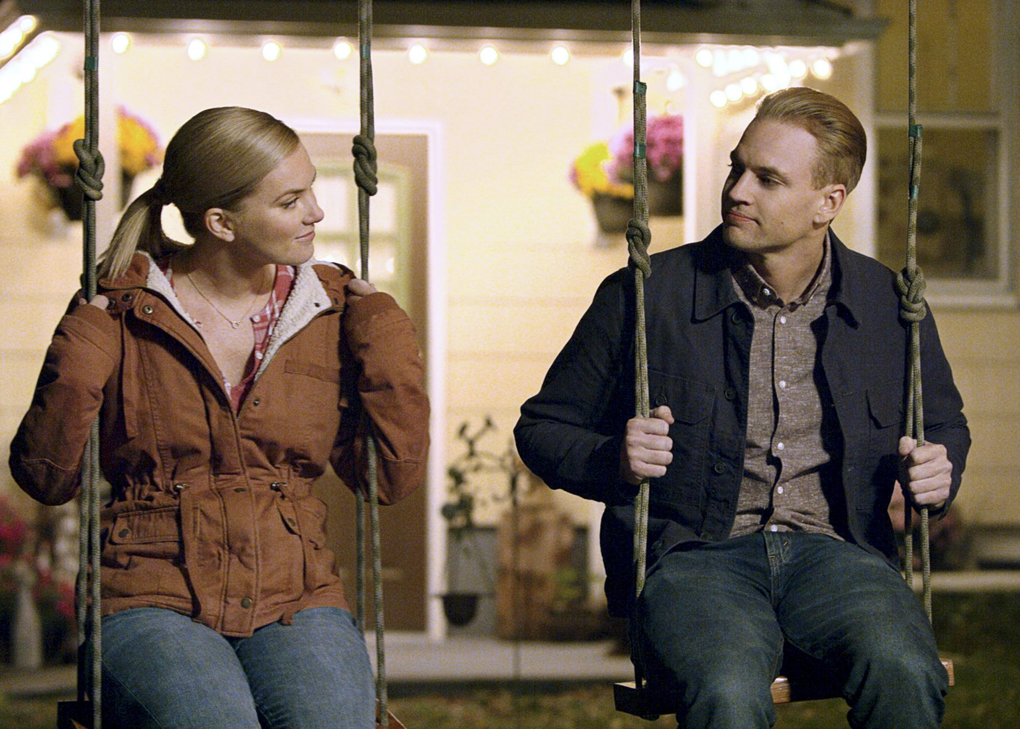 man and woman on swings