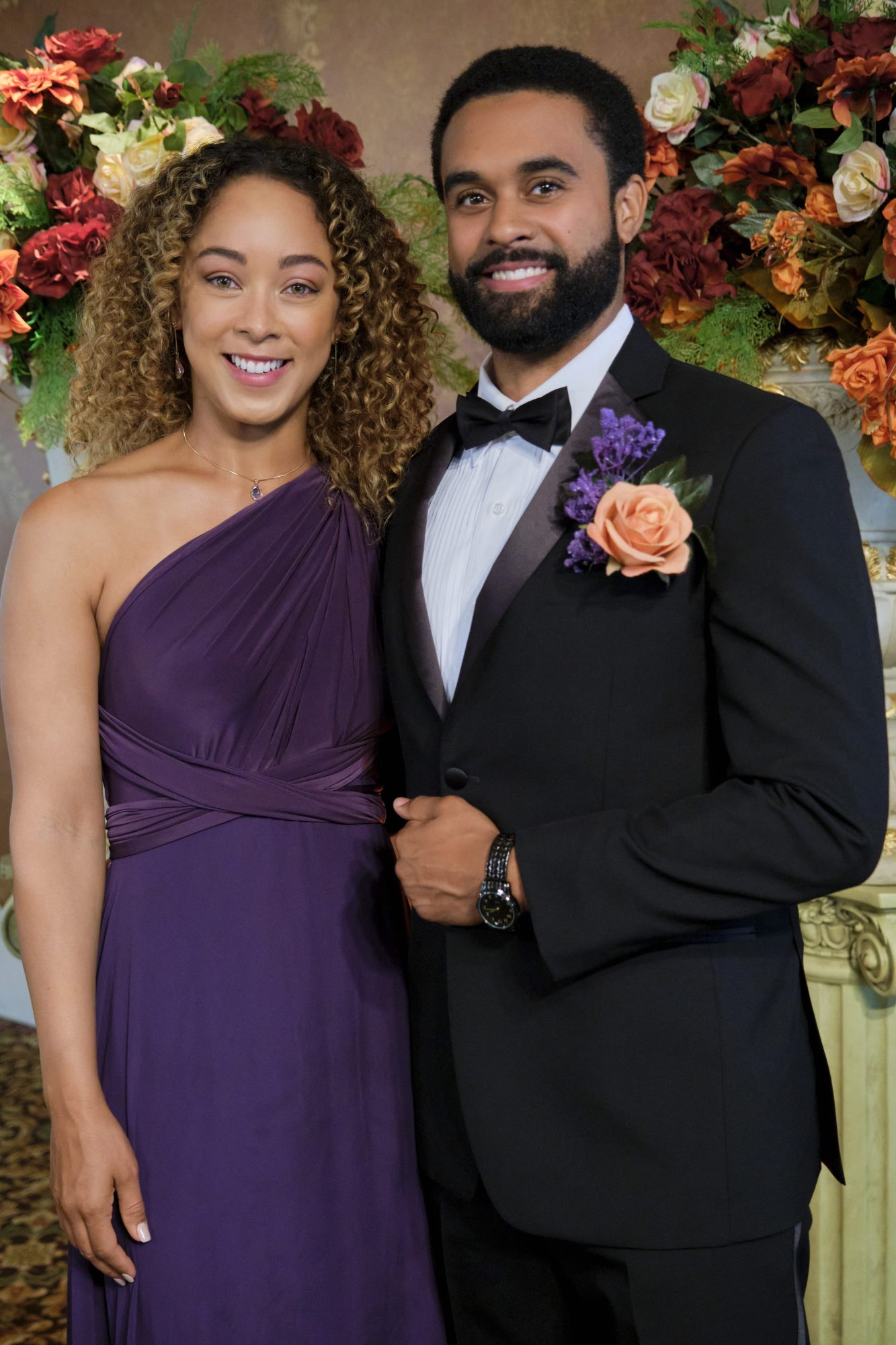 man in suit and girl in purple dress