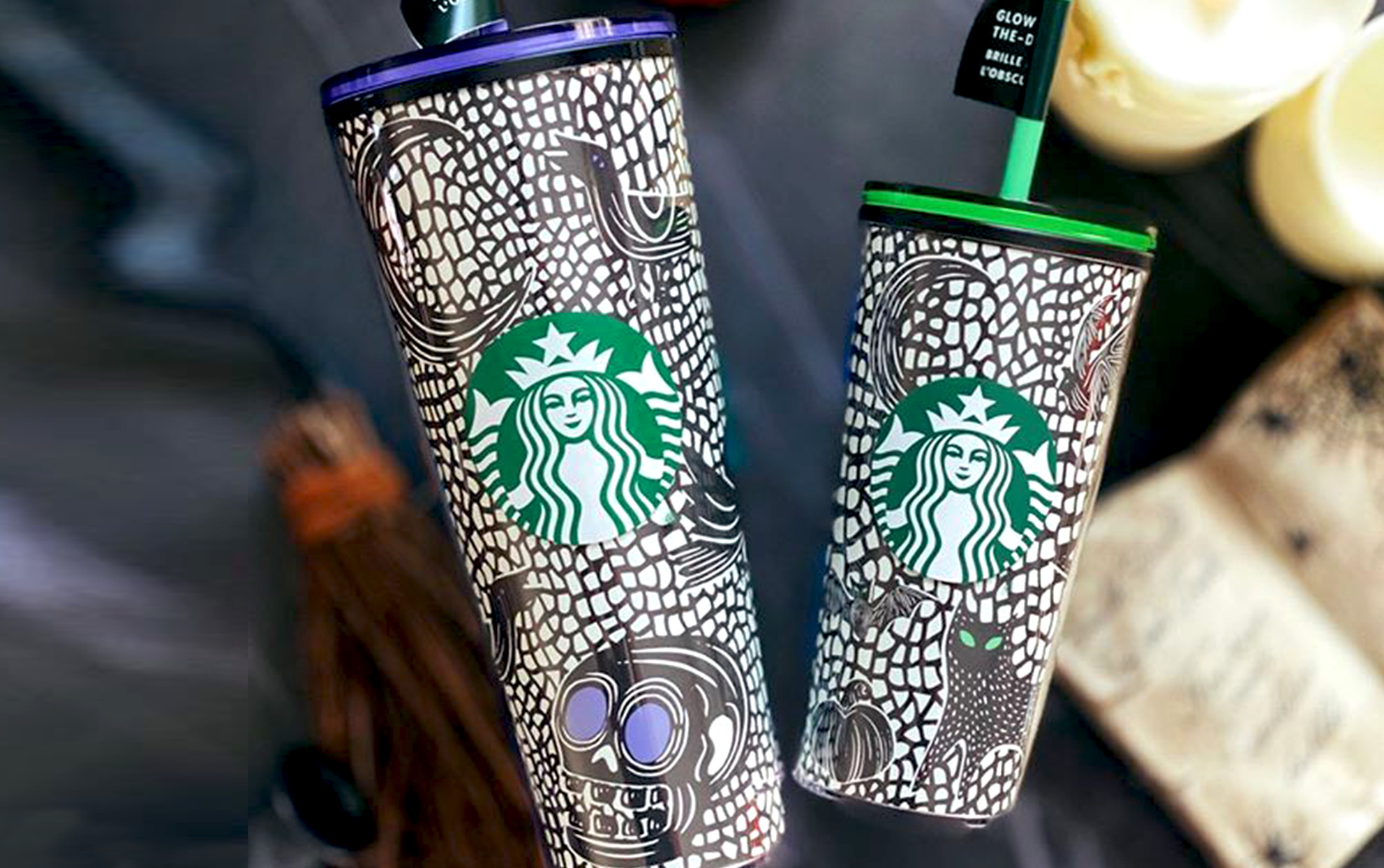 Two Starbucks Halloween plastic cups on a dark background