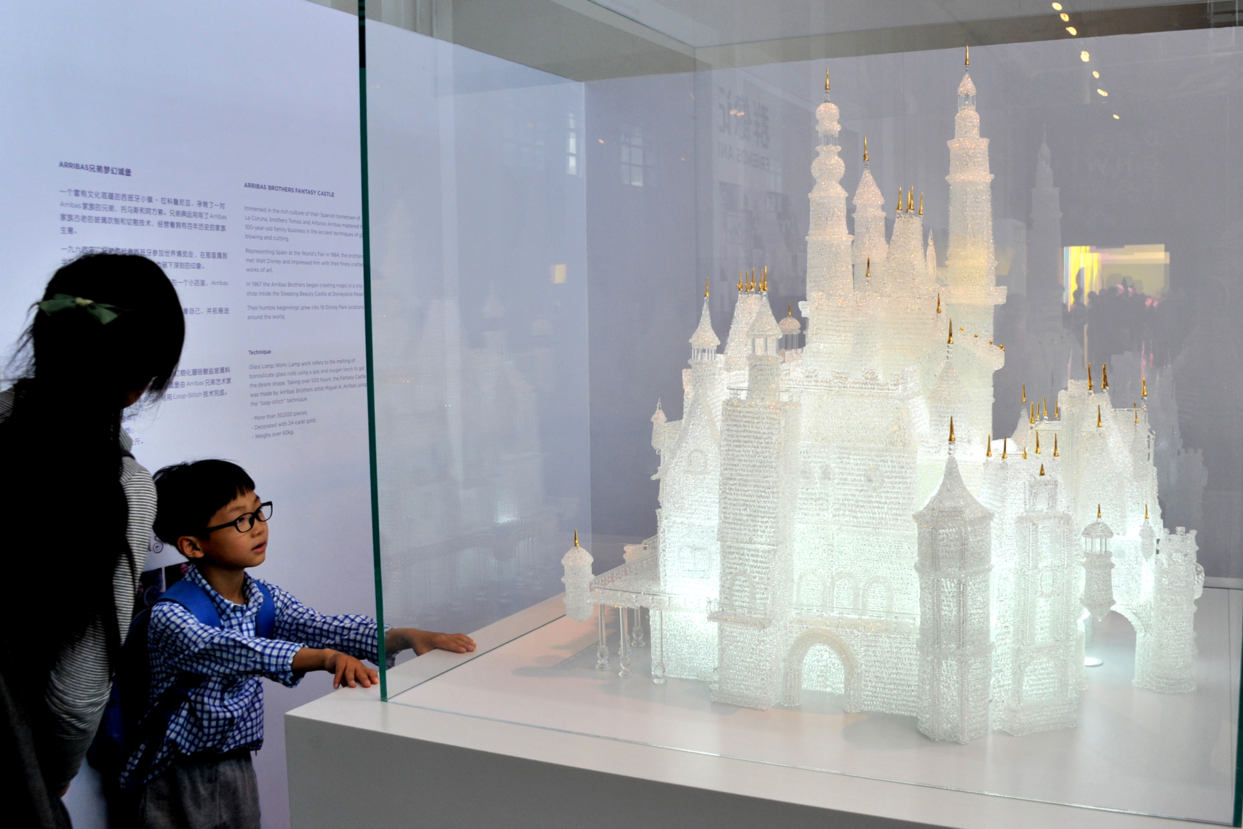 Citizens and visitors look a glass sculpture of Disney castle at Shanghai Museum of Glass during International Museum Day on May 18, 2016 in Shanghai, China.