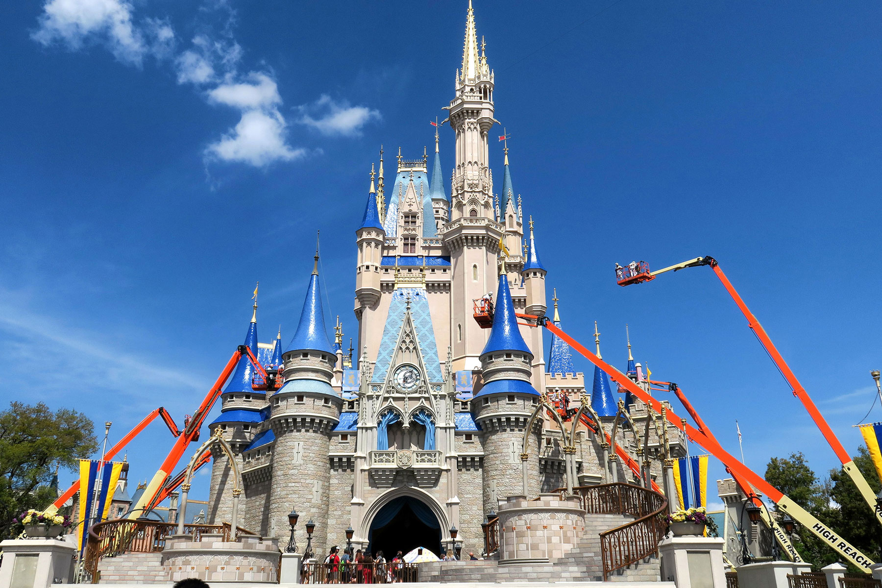 workers paint Cinderella Castle at Disney World
