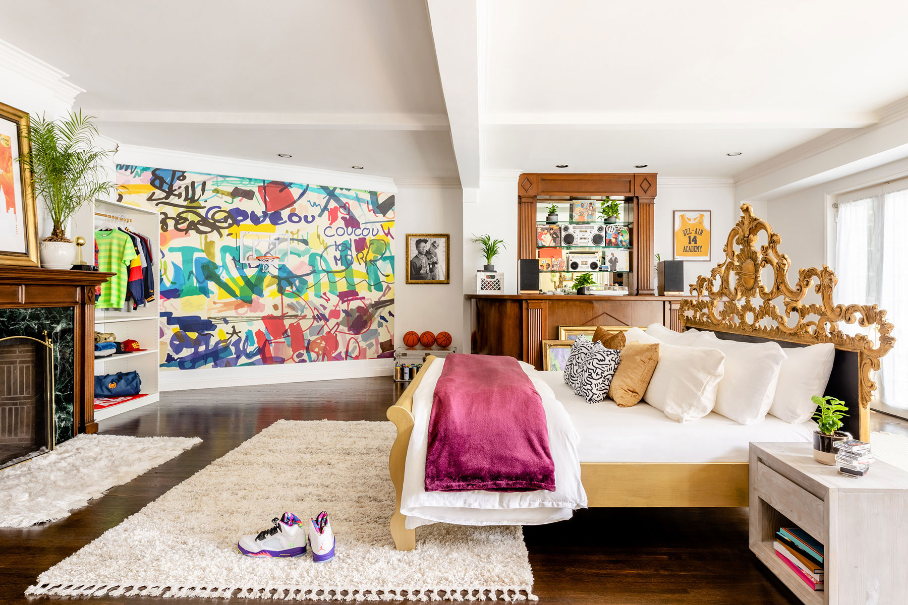 Graffiti wall and gold bed in large bedroom