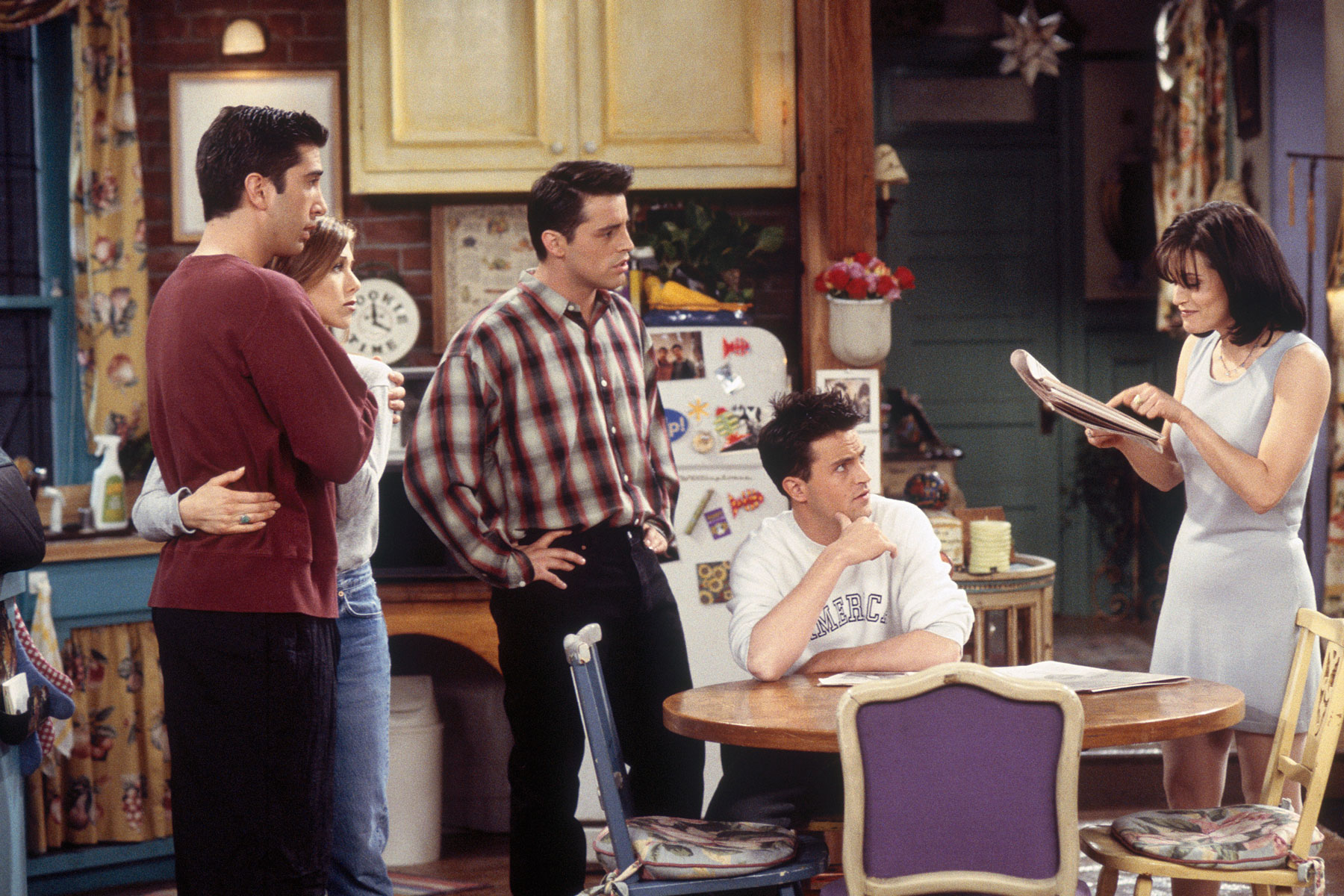 "The cast of ""Friends"" in the show's iconic kitchen"