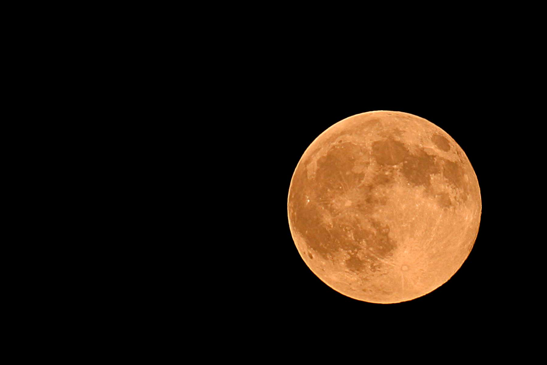 "An orange ""harvest moon"" rises over Manassas, Virginia"
