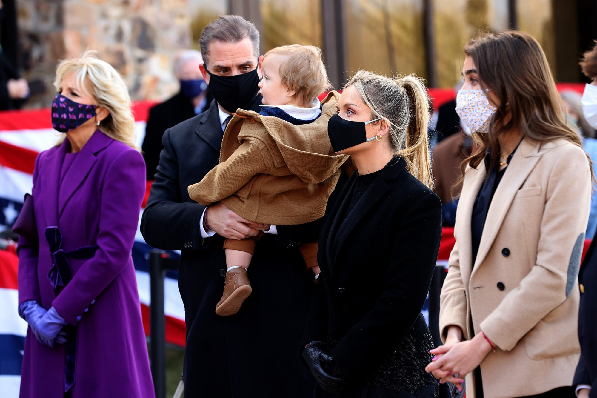 "Jill Biden, Hunter Biden, his infant son with wife Melissa Cohen and other members of President-elect Joe Biden's family attend a farewell ceremony at the Major Joseph R. ""Beau"" Biden III National Guard/Reserve Center January 19, 2021"