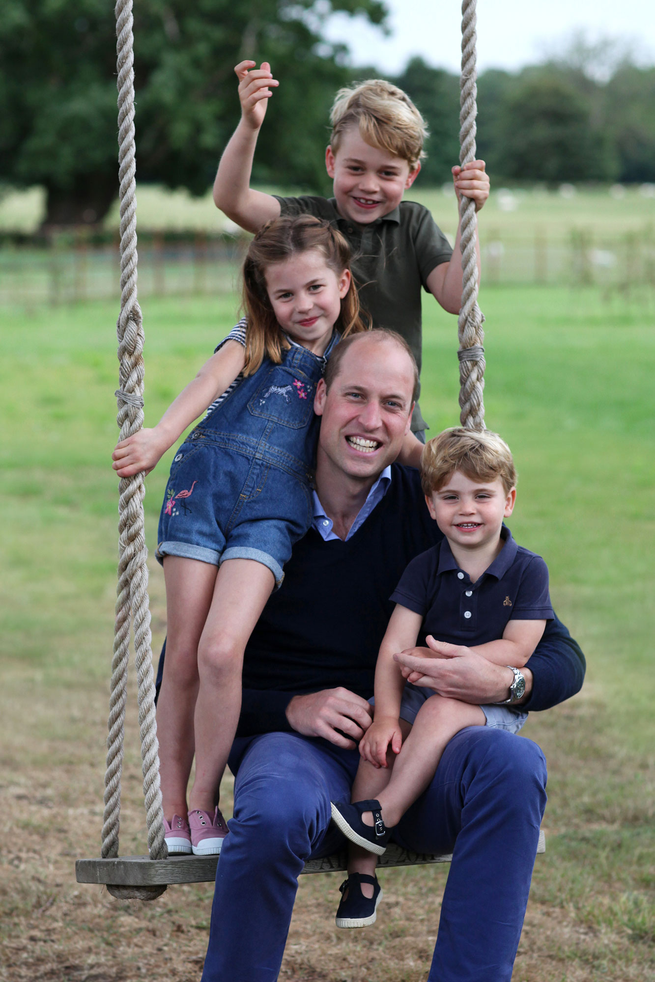 Prince William and kids on swing