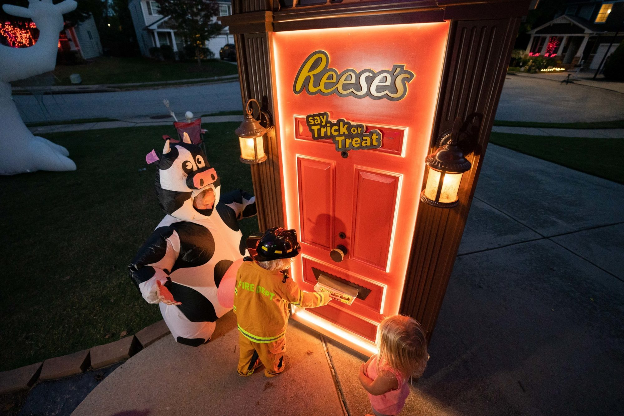 reeses trick or treating door dispenses candy
