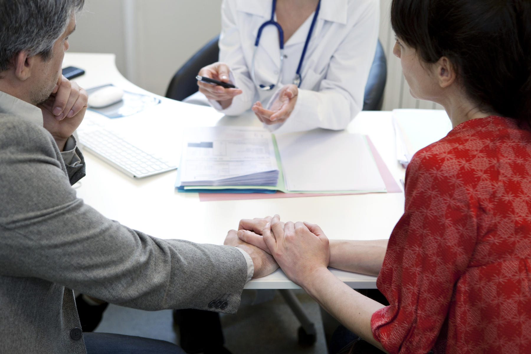couple discussing fertility options with doctor