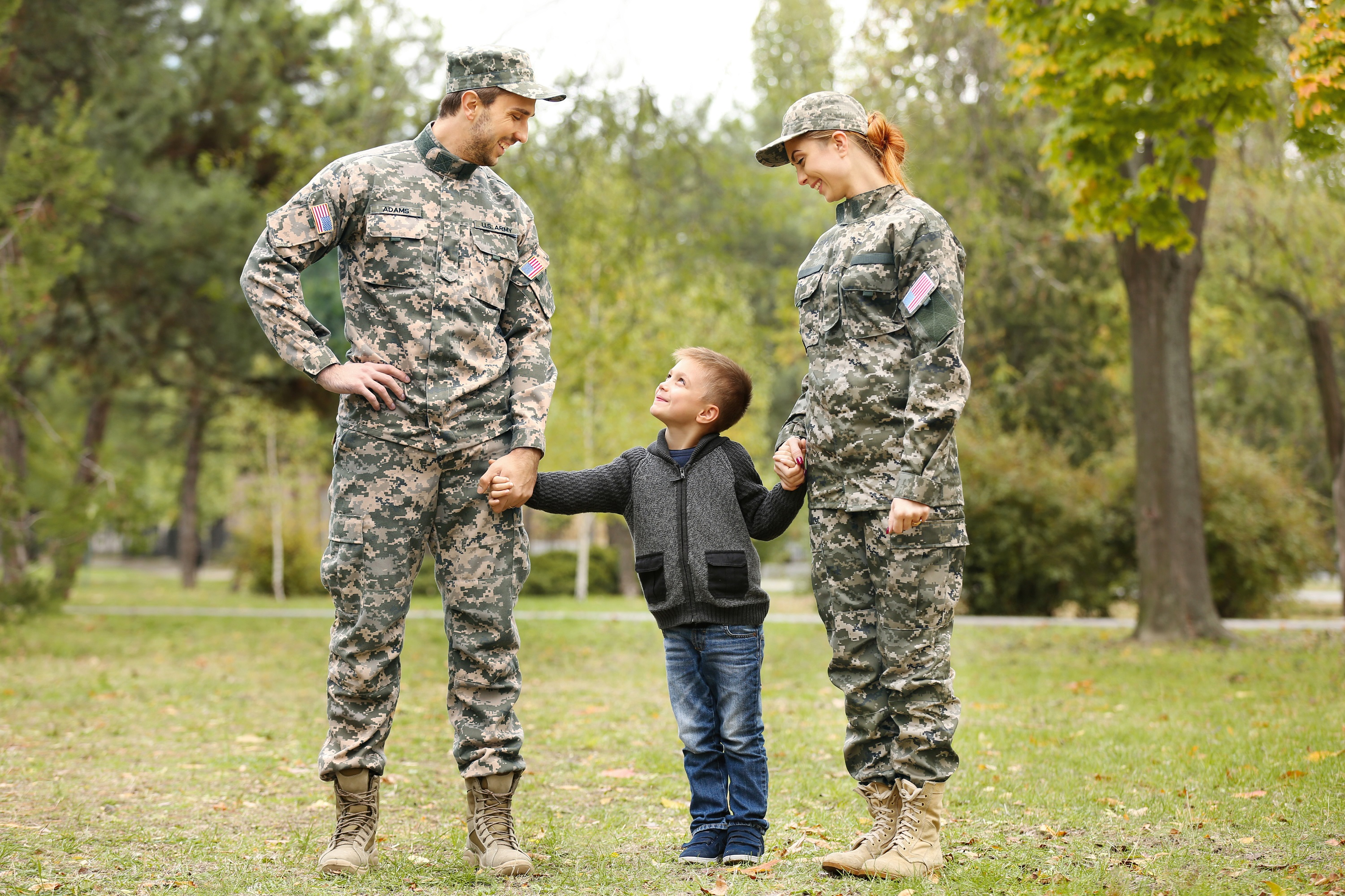 Military Parents Mom and Dad Holding Hands With Son