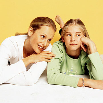 Mother Talking to Teenage Daughter with Yellow Background