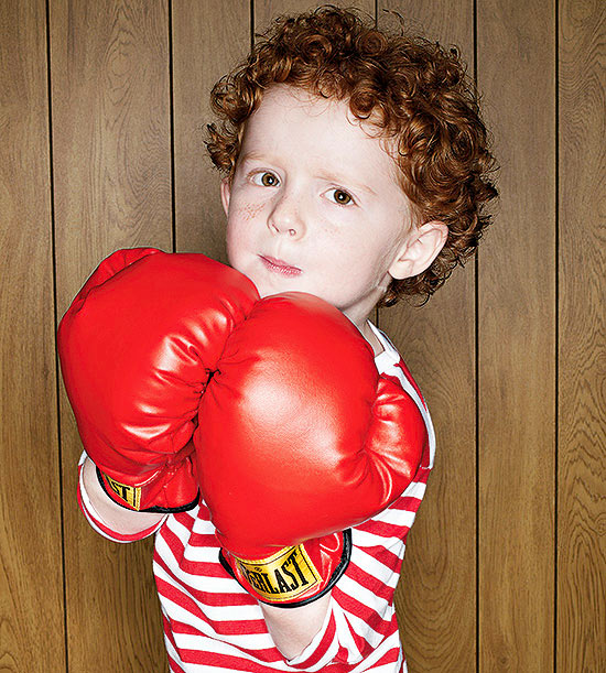 boy wearing boxing gloves