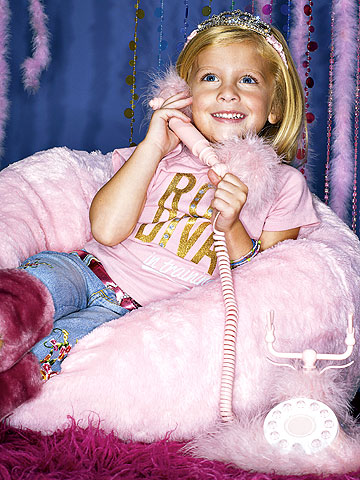 blond girl wearing tiara and talking on phone