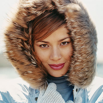 woman wearing coat with fur hood