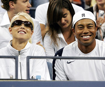 Tiger Woods with wife