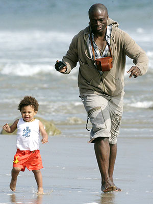 Seal and son Henry on beach