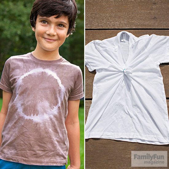 Boy in brown t-shirt with white circle