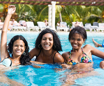 women vacationing in pool