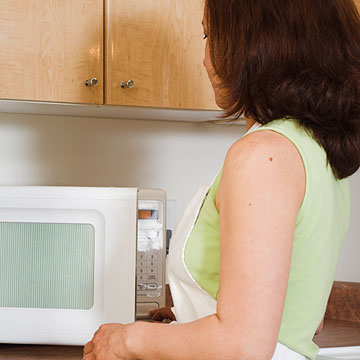 Woman using the microwave