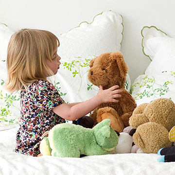 child playing with stuffed animals