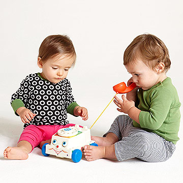 babies playing together