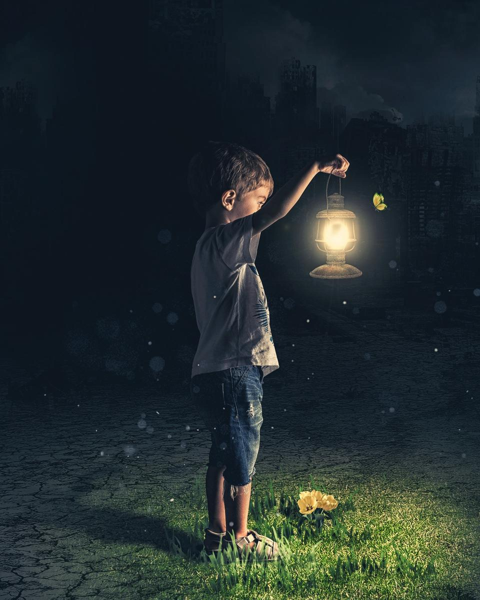 Young Boy Holding Lantern Outside Nighttime