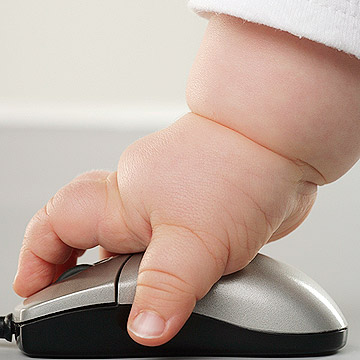 baby hand on computer mouse
