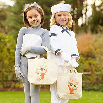 Kids holding trick-or-treat bags